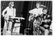 INSERT PIC 38 ONSTAGE WITH MAC DAVIS 1977